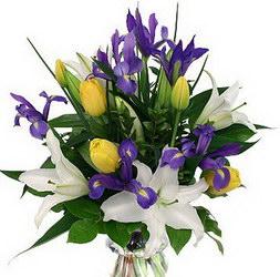 «Гармония» Яркий и ароматный букет создаст позитивное настроение. Выполнен из тюльпанов, ирисов, зелени и лилий. Доставка в Мингрельскую.